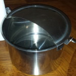 Milking pail with a half moon lid.